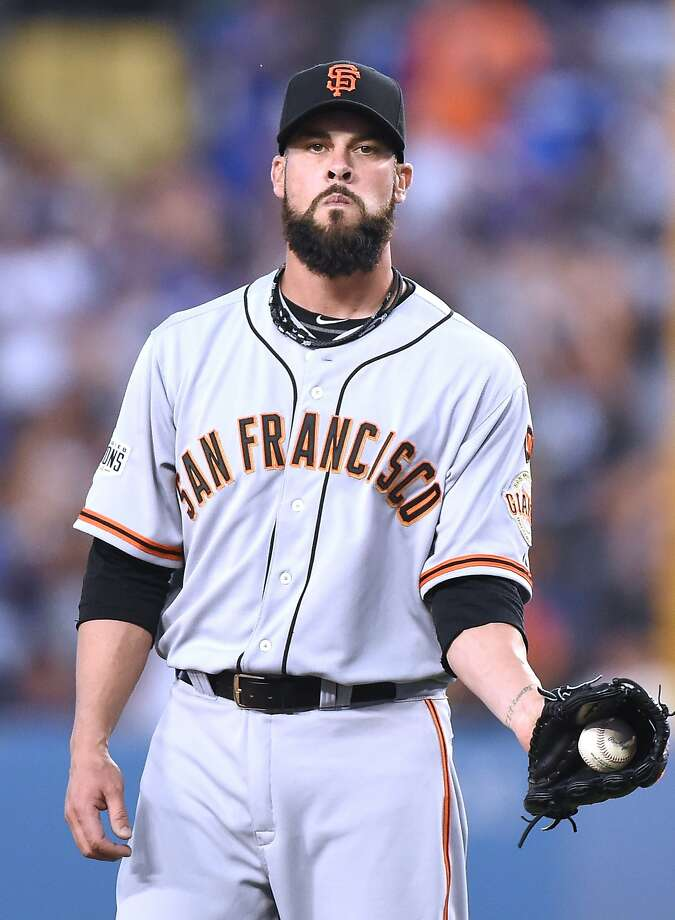 Ryan Vogelsong reacts after Andre Ethier hit the Dodgers' third homer in the first. Photo: Harry How, Getty Images