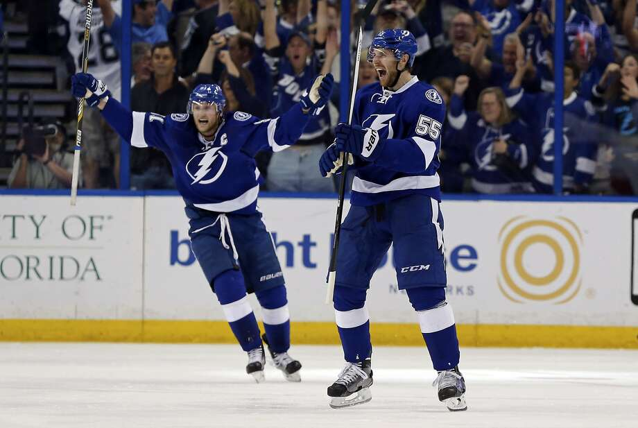 Braydon Coburn (right) of the Lightning celebrates his goal with teammate Steven Stamkos in Game 7 of the Eastern Conference quarterfinals. Tampa Bay defeated Detroit to advance. Photo: Mike Carlson, Getty Images