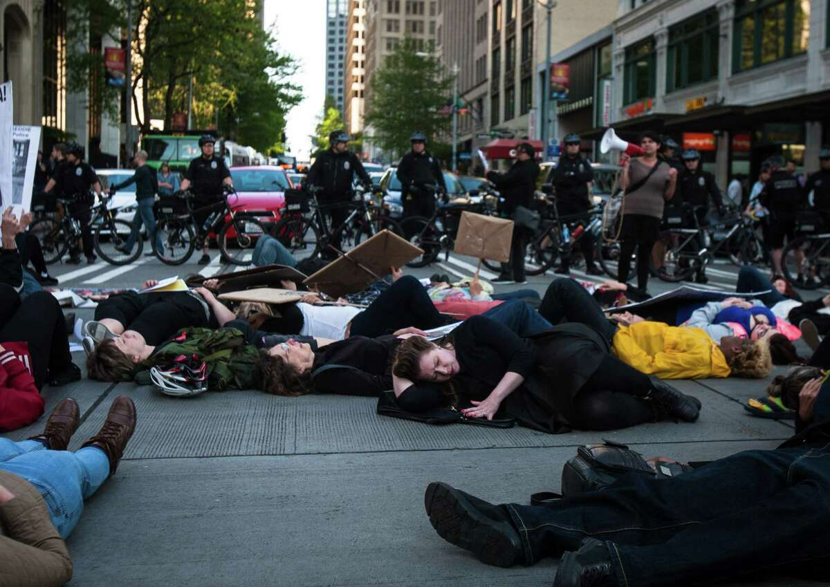 Protesters participate in a die-in during a protest against police brutality at Westlake Center on Wednesday, April 29, 2015. On this day, people gathered in cities across the nation including New York, Boston and Minneapolis to support Baltimore in demanding justice and reform after the death of Freddie Gray.