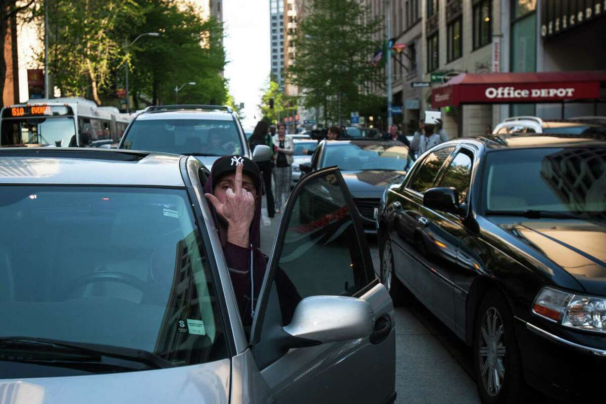 A person stuck in traffic caused by the protest expressed his anger by flipping off the crowd on Wednesday, April 29, 2015. On this day, people gathered in cities across the nation including New York, Boston and Minneapolis to support Baltimore in demanding justice and reform after the death of Freddie Gray.