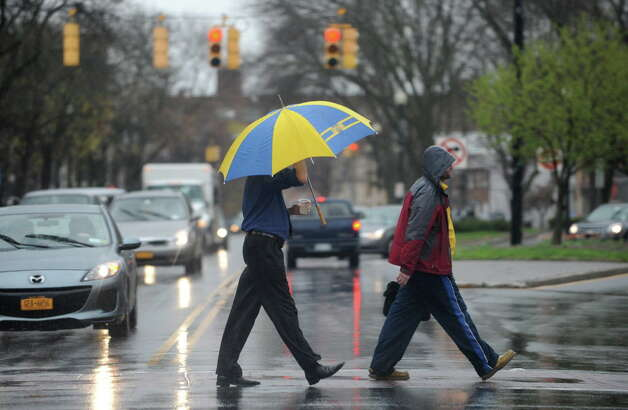 Pedestrians cross Central Ave. near Lark St. in the rain Wednesday, April 30, 2014 in Albany, N.Y  (Lori Van Buren / Times Union) Photo: Lori Van Buren