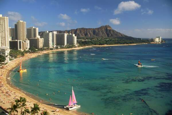 7. Honolulu:  Waikiki Beach woos visitors to Hawaii's capital with views of Diamond Head, steady waves for surfers and plenty of hotel rooms.   Hilton Hawaiian Village  has just completed a $21 million renovation of its  380-room, 17-story Diamond Head Tower. Visitors without a car can also now explore the island in luxury mini-coaches (leather reclining seats, personal A/C vents, bay windows, oshibori towels) on new tours from  Hoku Hawaii Tours .