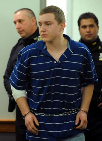 Shane Harding enters Troy City Court  (Skip Dickstein / Times Union)
