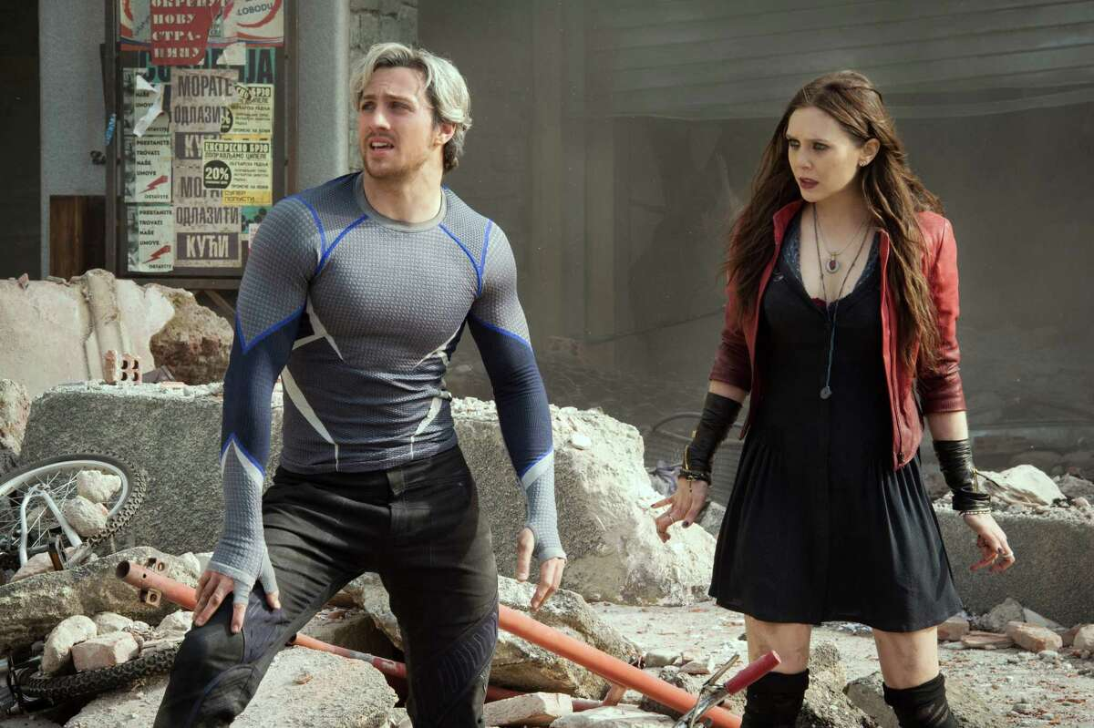 This photo provided by Disney/Marvel shows, Aaron Taylor-Johnson, left, as Quicksilver/Pietro Maximoff , and Elizabeth Olsen as Scarlet Witch/Wanda Maximoff, in a scene from the film,