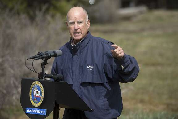 California Gov. Jerry Brown speaks to members of the press during the annual snowpack survey in Phillips, Calif., on Wednesday, April 1, 2015. For the first time since measurements began in 1942, there was no snow to measure on this date. (Randall Benton/Sacramento Bee/TNS)