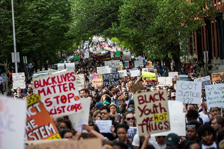 "Students from Baltimore colleges and high schools march in protest chanting ""justice for Freddie Gray"" on Wednesday. Photo: Andrew Burton, Getty Images"