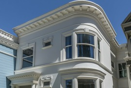 The Queen Anne Victorian was built in the early 1900s and includes curved windows and a covered portico.
