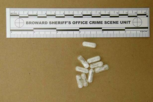 This Feb. 12, 2015 photo made available by the Broward Sheriff's Office, Fla.,  shows confiscated vials of flakka. This emerging drug can alter brain chemistry in such a way that users can't control their thoughts and it can increase adrenalin.