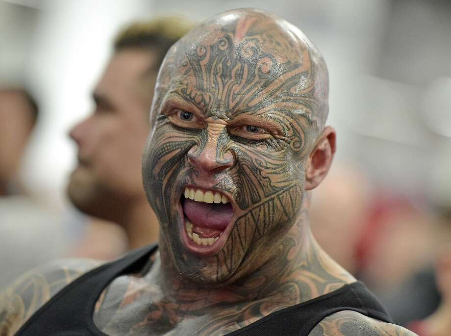 Tattooed bodybuilder Jens Dalsgaard from Denmark shouts as he poses at the FIBO Power, a bodybuilding fair in Cologne, Germany, Thursday, April 9, 2015. (AP Photo/Martin Meissner) Photo: Martin Meissner, Associated Press