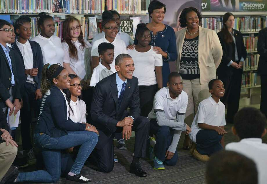 President Obama poses with students after speaking at a live virtual field trip with students from around the country at the Anacostia Library on April 30 in Washington, D.C. Photo: MANDEL NGAN / AFP/Getty Images / AFP