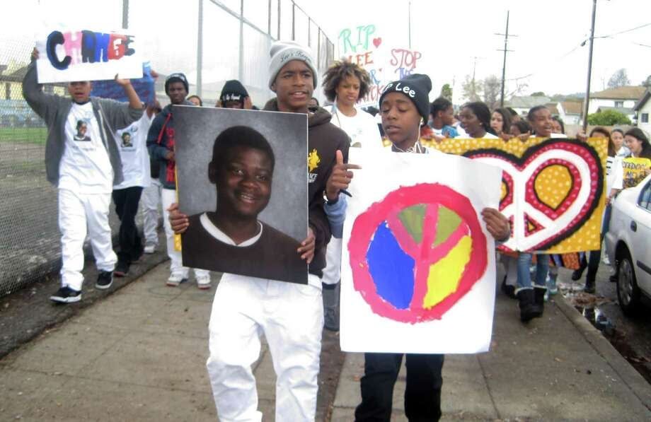 Students of Alliance Academy, including Diamond Allen (far left), march in February 2014 to remember classmate Lee Weathersby III, who was shot and killed in Oakland. Photo: Zaidee Stavely/KQED / Zaidee Stavely/KQED
