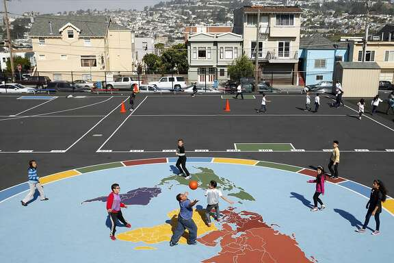 Monroe Elementary School play on a world map in the school playground during recess in San Francisco, Calif., on Wednesday, April 29, 2015.