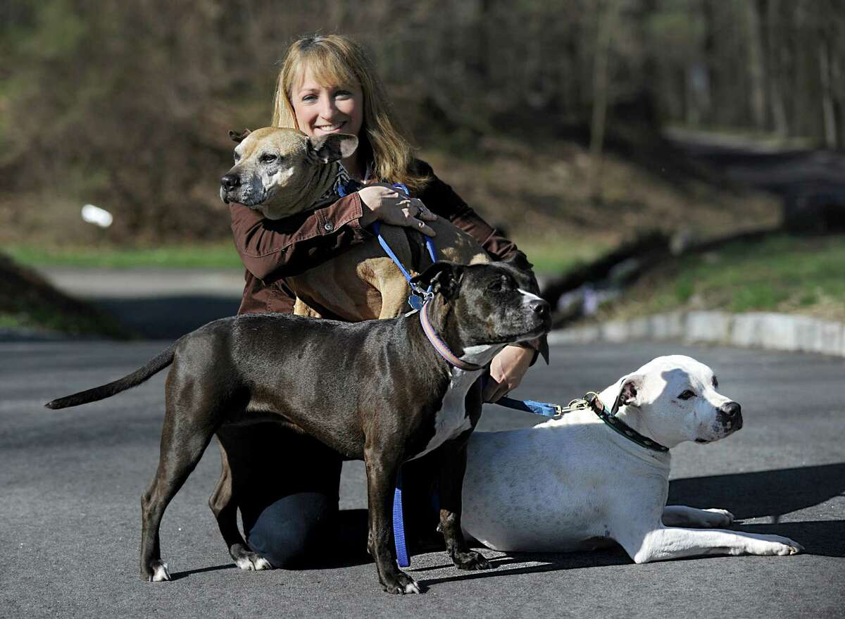 Laurie Hollywood, Stamford's former animal control manager is photographed with her dogs at her Newtown, Conn. home, Thursday, April 30, 2015.