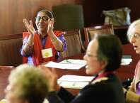 Bhama Narasimhan, of Greenwich, claps while participating in the Super Noggin brain game at the Greenwich Senior Center in Greenwich, Conn. Thursday, April 30, 2015.  Super Noggin is a comprehensive program teaching brain-healthy habits and tracking individual progress through a variety of fun physical and mental activities.  The 11-week class costs $20 and takes place at the Greenwich Senior Center on Thursdays and Greenwich Library on Fridays.