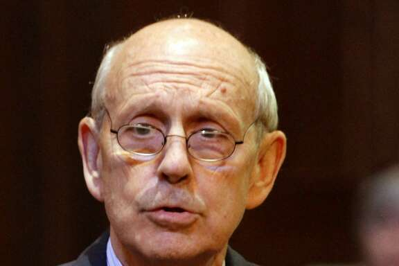 In this Oct. 6, 2011 file photo, Supreme Court Justice Stephen Breyer in Richmond, Va. A Supreme Court spokeswoman says Breyer was robbed last week by a machete-wielding intruder at his vacation home in the West Indies. (AP Photo/Steve Helber, File)