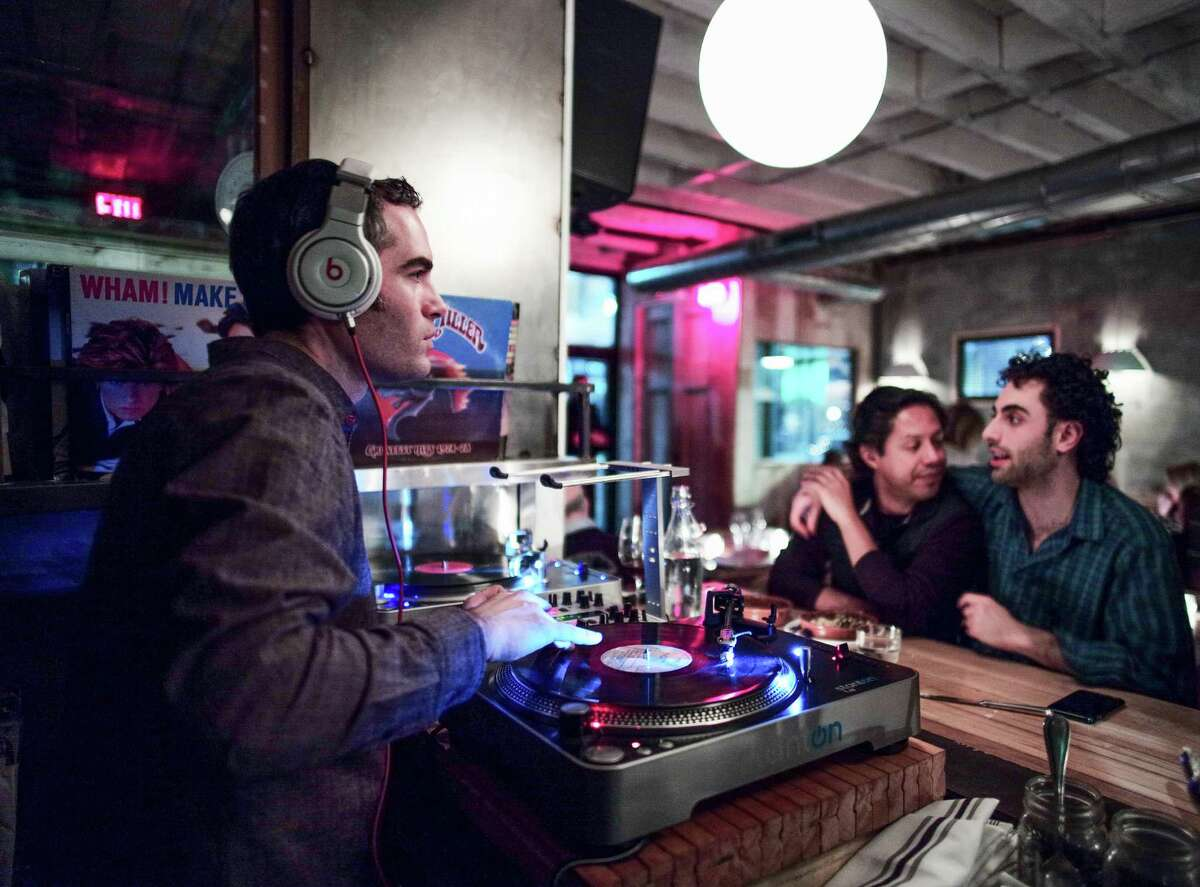 Peck's Arcade owner Vic Christopher also DJs at the restaurant. (Richard Lovrich photo)