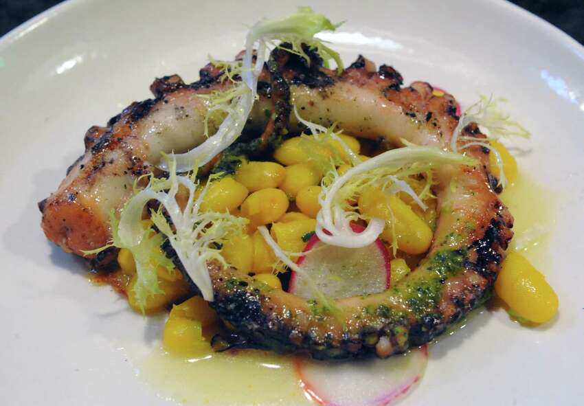 Octopus with saffron beans, N'duja and frisee at Peck's Arcade on Wednesday April 22, 2015 in Troy, N.Y. (Michael P. Farrell/Times Union)