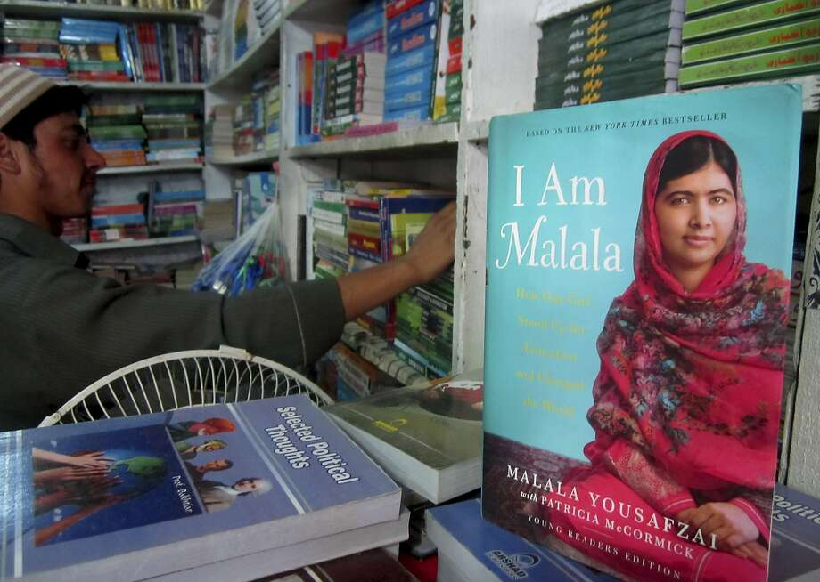 A book about Pakistan's Nobel Prize winner Malala Yousafzai, who survived the Taliban's attack, is on display at a bookstore in Malala's home town of Mingora, Pakistan. Photo: Naveed Ali, Associated Press