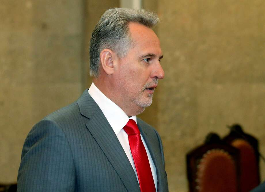 Ukrainian oligarch Dmitry Firtash waits for the start of his trial at the main court in Vienna. Firtash was arrested in Vienna in March 2014 on an American warrant charging him with bribery and other offenses. Photo: Ronald Zak, Associated Press