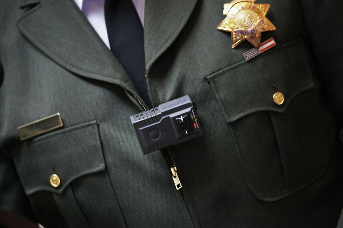 San Francisco Sheriff Ross Mirkarimi wearing a police body camera for a news conference in City Hall San Francisco, Calif., Thursday April 30, 2015.