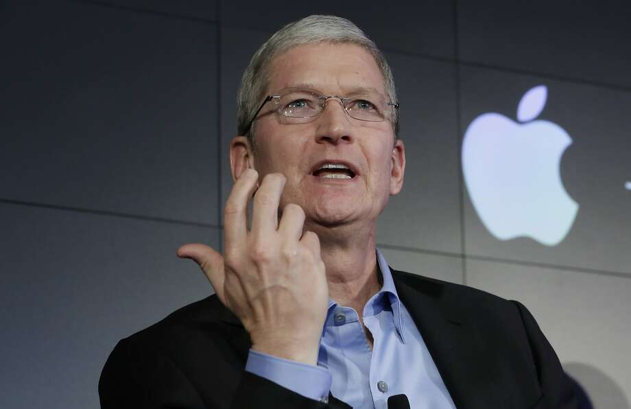 Employment rights groups want Apple CEO Tim Cook to adjust the company's practice. Photo: Richard Drew, Associated Press