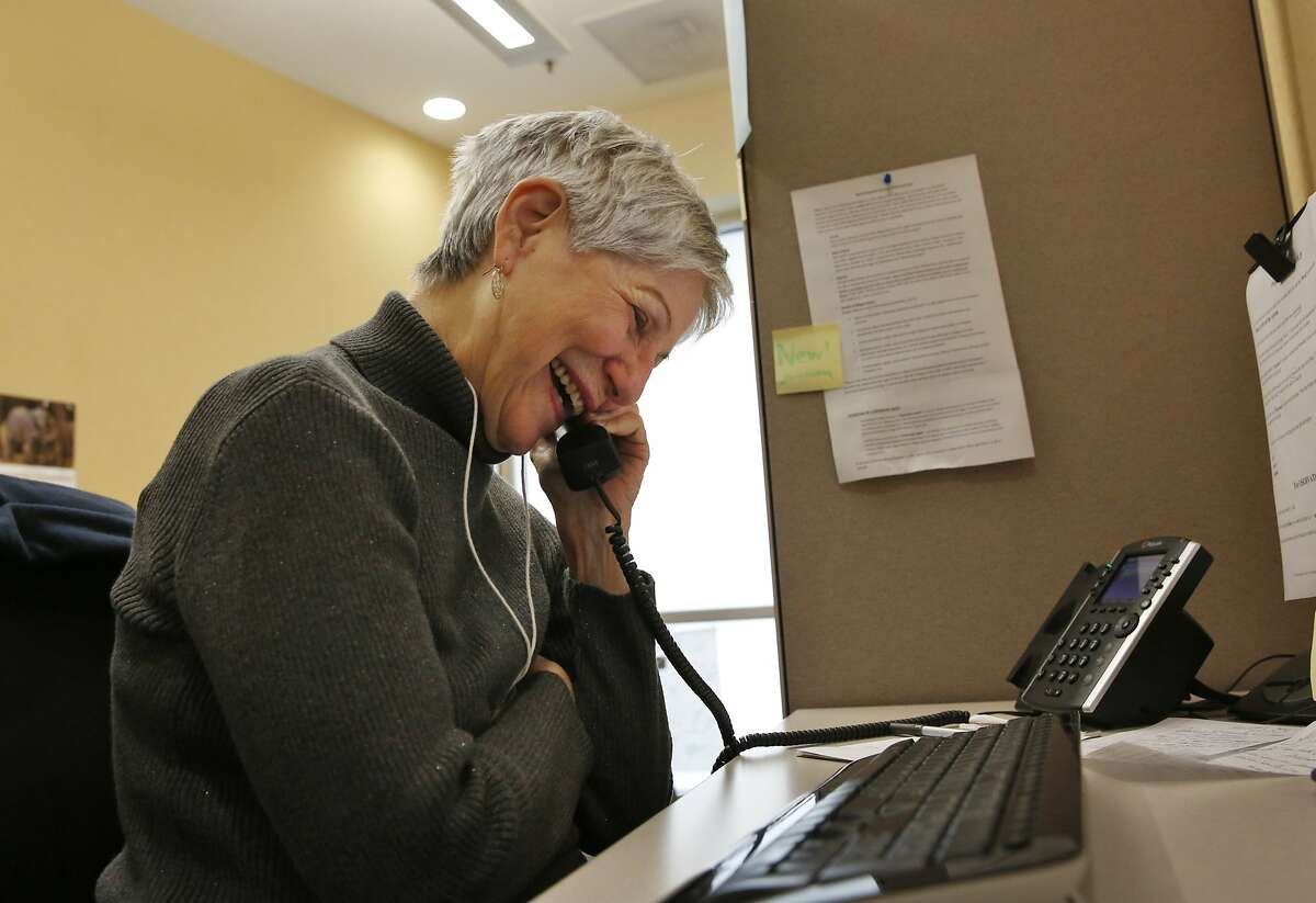 """Jobyna Dellar chats with a client on the phone in the Friendship Line office at the Institute on Aging April 30, 2015 in San Francisco, Calif. Dellar has been a volunteer for almost two years and says she loves it. """"I just really like making people laugh,"""" she said. The warm line, which is a 40-year-old program, is run through the Institute on Aging's Center for Elderly Suicide Prevention and Grief-Related Services provides crisis intervention. Counselors provide well-being check-ins, medical reminders and emotional support to anyone who calls in."""
