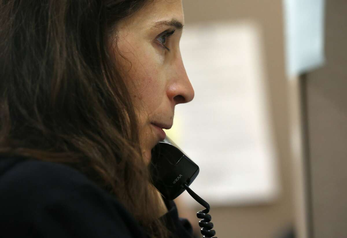 Leah Khaghani talks with a client over the phone in the Friendship Line office at the Institute on Aging April 30, 2015 in San Francisco, Calif. The warm line, which is a 40-year-old program, is run through the Institute on Aging's Center for Elderly Suicide Prevention and Grief-Related Services provides crisis intervention. Counselors provide well-being check-ins, medical reminders and emotional support to anyone who calls in.