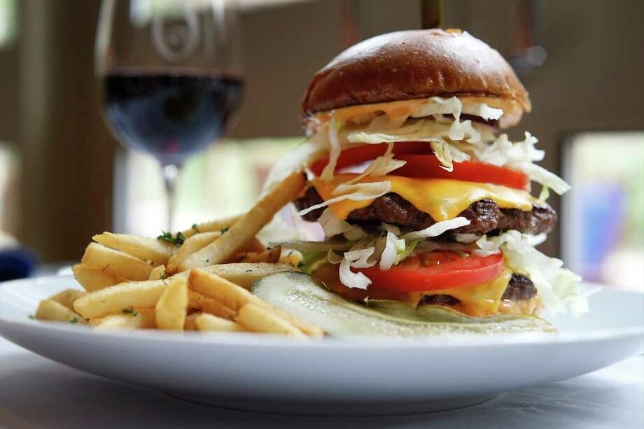 Image of a stacked cheeseburger for the review of Ostra, the signature restaurant at the Mokara Hotel & Spa, on Tuesday, Apr. 28, 2015. (Kin Man Hui/San Antonio Express-News) Photo: Photos By Kin Man Hui / San Antonio Express-News / ©2015 San Antonio Express-News