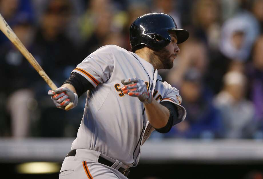 San Francisco Giants first baseman Brandon Belt (9) singles against the Colorado Rockies in the fourth inning of a baseball game Friday, April 24, 2015, in Denver. (AP Photo/David Zalubowski) Photo: David Zalubowski, Associated Press