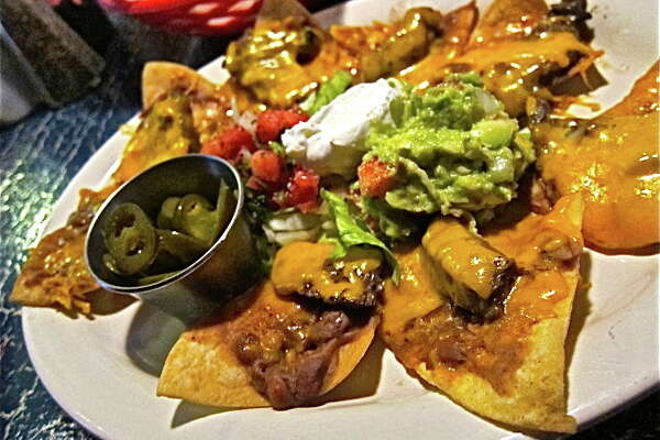 Soto's Cantina (Tex-Mex):    This family-owned Tex-Mex spot on the north side features a cheerful dining room, well-prepared classics, such as chiles rellenos, pork tamales in chili gravy and shrimp in a rich chipotle sauce. 10609 Grant, 281-955-5667