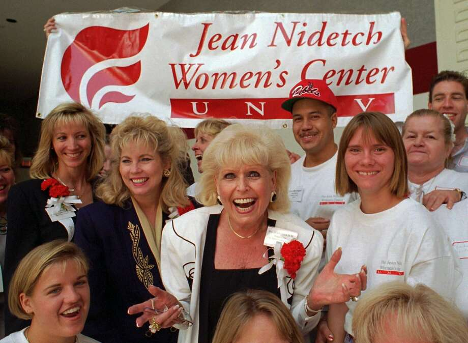 Jean Nidetch (center), who helped found Weight Watchers International in 1963, attends a 1995 job fair  at the University of Nevada in Las Vegas with workers from the Jean Nidetch Women's Center. Photo: Lennox McLendon, Associated Press