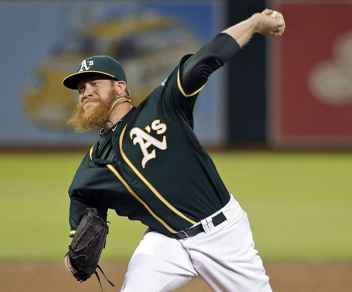 FILE - In this July 23, 2014, file photo, Oakland Athletics relief pitcher Sean Doolittle throws to the Houston Astros during the ninth inning of a baseball game in Oakland, Calif. Doolittle's girlfriend Eireann Dolan had no idea she would inspire a movement just by offering her support to the gay community.(AP Photo/File)