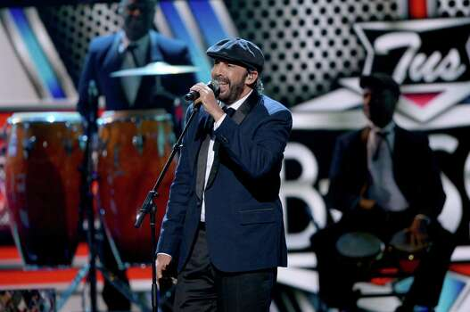 MIAMI, FL - FEBRUARY 19:  Juan Luis Guerra performs onstage at the 2015 Premios Lo Nuestros Awards at American Airlines Arena on February 19, 2015 in Miami, Florida.  (Photo by Rodrigo Varela/Getty Images For Univision) Photo: Rodrigo Varela, Getty Images/File Photo / 2015 Getty Images