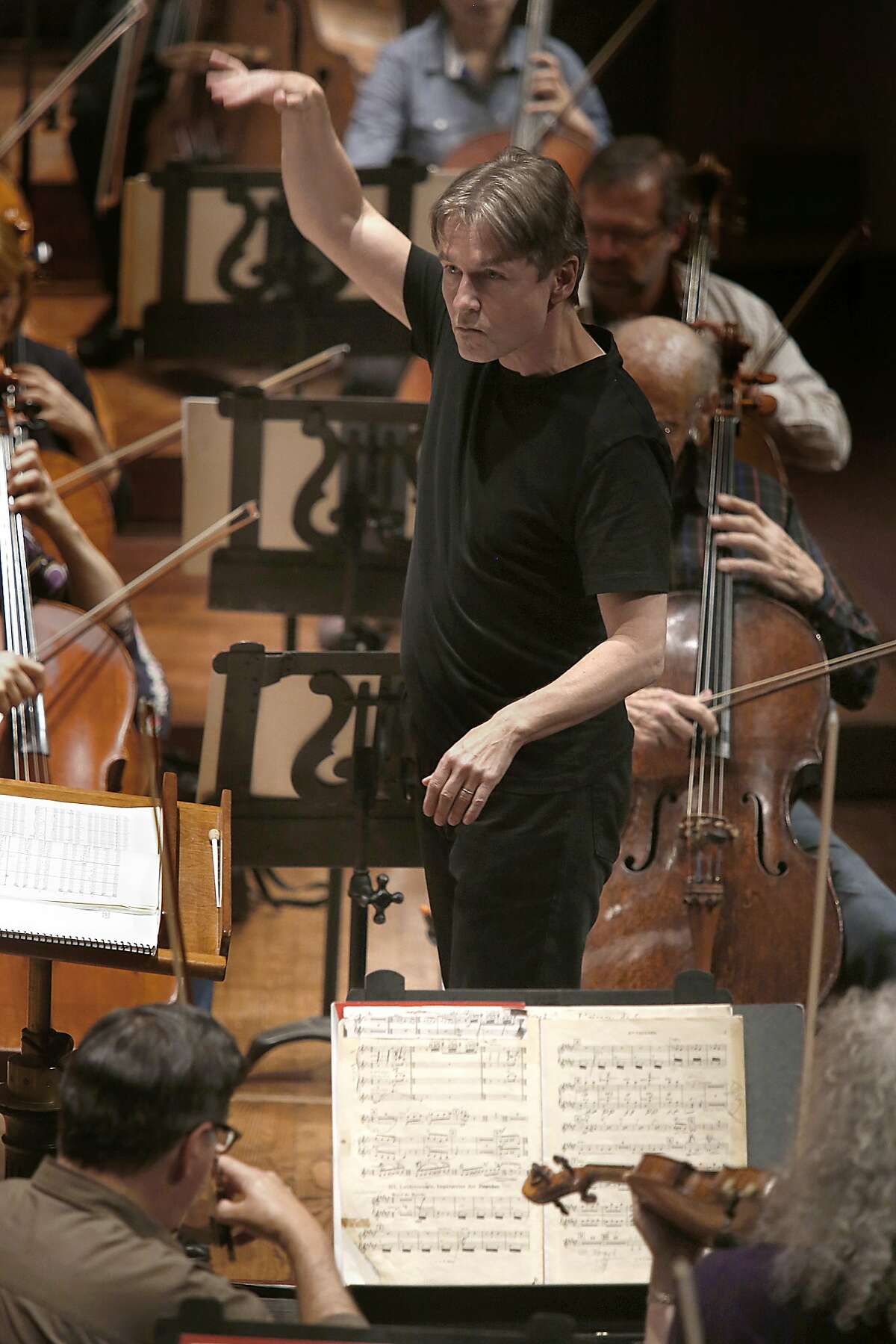 Esa-Pekka Salonen conducts during a rehearsal with the San Francisco symphony at Davies Hall in San Francisco, California, on Wednesday, April 29, 2015.