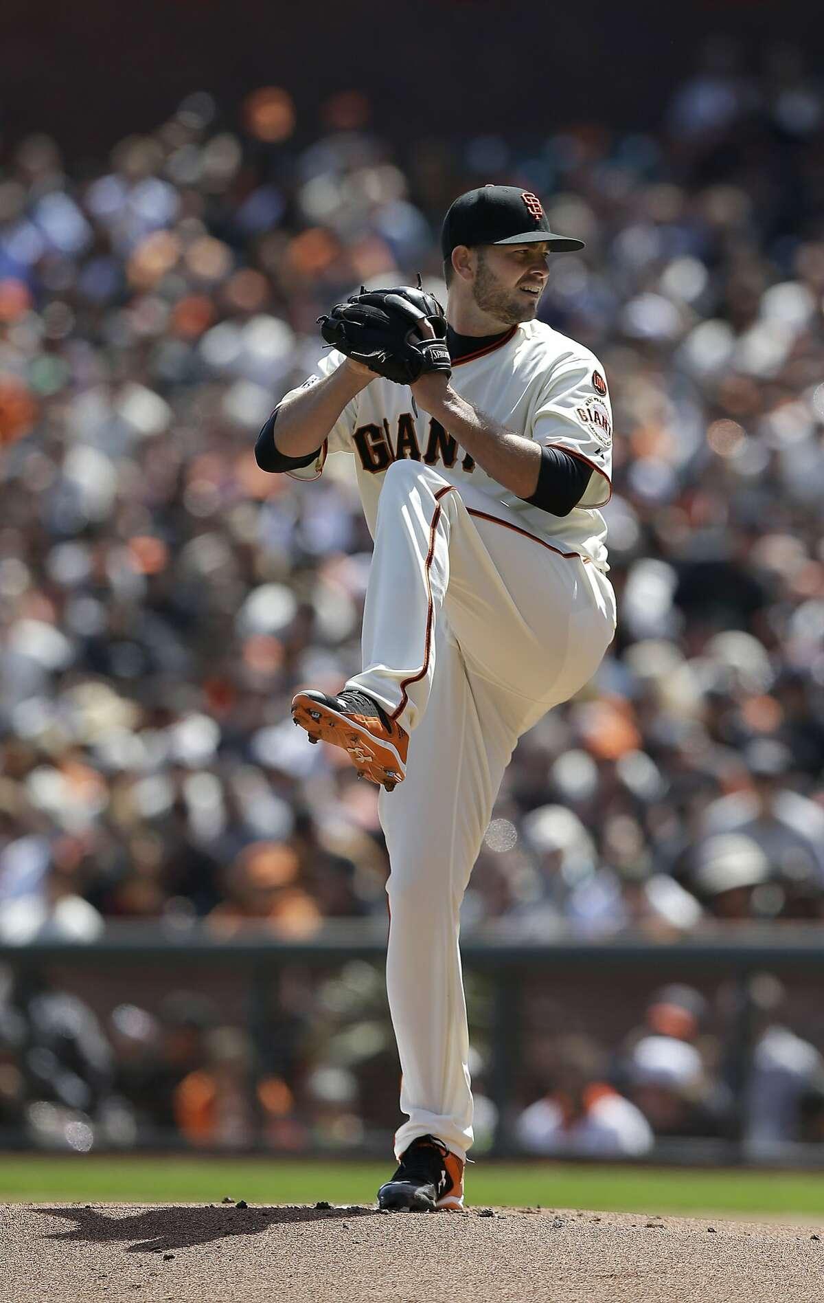 San Francisco Giants pitcher Chris Heston throws against the Colorado Rockies during a baseball game in San Francisco, Monday, April 13, 2015. (AP Photo/Jeff Chiu)