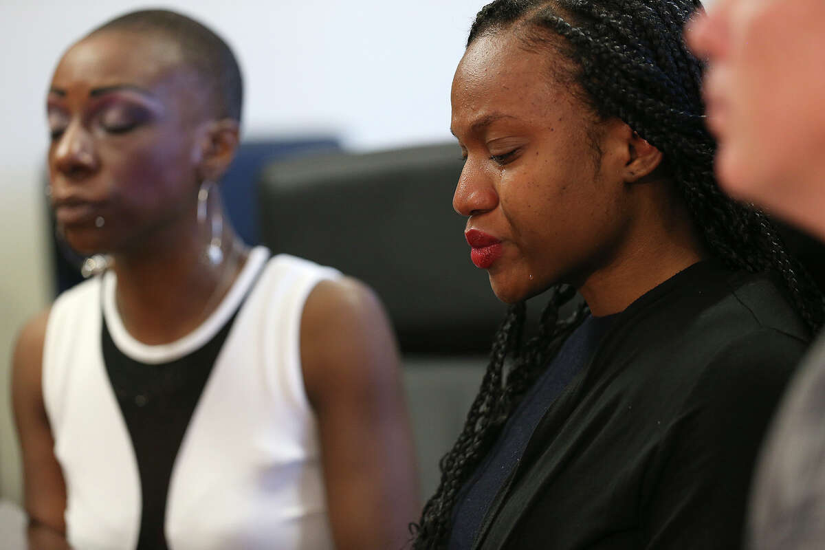 During a news conference Thursday, Ajuana Baldwin, right, reacts as she recalls details of a wreck with an SUV that was carrying Mayor Ivy Taylor and being driven by a San Antonio police officer April 18. Baldwin, her mother, Sharlene Lewis, left, and her sister, Tomekia Baldwin, have filed a lawsuit against the City of San Antonio, claiming the crash was the officer's fault. Tomekia Baldwin was injured in the crash and remains at San Antonio Military Medical Center in serious condition. On Wednesday, San Antonio police concluded that the vehicle with the mayor had the right of way. Jahson Arneaud, who was driving the car that with the two sisters, said he had the right of way.
