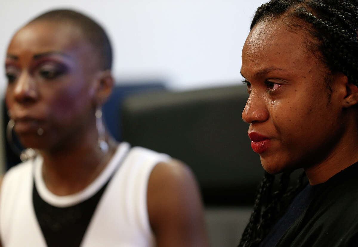 During a news conference Thursday, Ajuana Baldwin, right, reacted as she recalled details of a wreck with an SUV that was carrying Mayor Ivy Taylor and being driven by a San Antonio police officer on April 18. Baldwin, her mother, Sharlene Lewis, left, and her sister, Tomekia Baldwin, have filed a lawsuit against the City of San Antonio, saying the officer was at fault. Tomekia Baldwin remains at San Antonio Military Medical Center in serious condition. Also a plaintiff in the lawsuit is Tomekia Baldwin's son, Noah Baldwin. On Wednesday, the police department's investigation concluded that the vehicle with the mayor had the right of way. The driver of the other vehicle, Jahson Arneaud, said he had the right of way.
