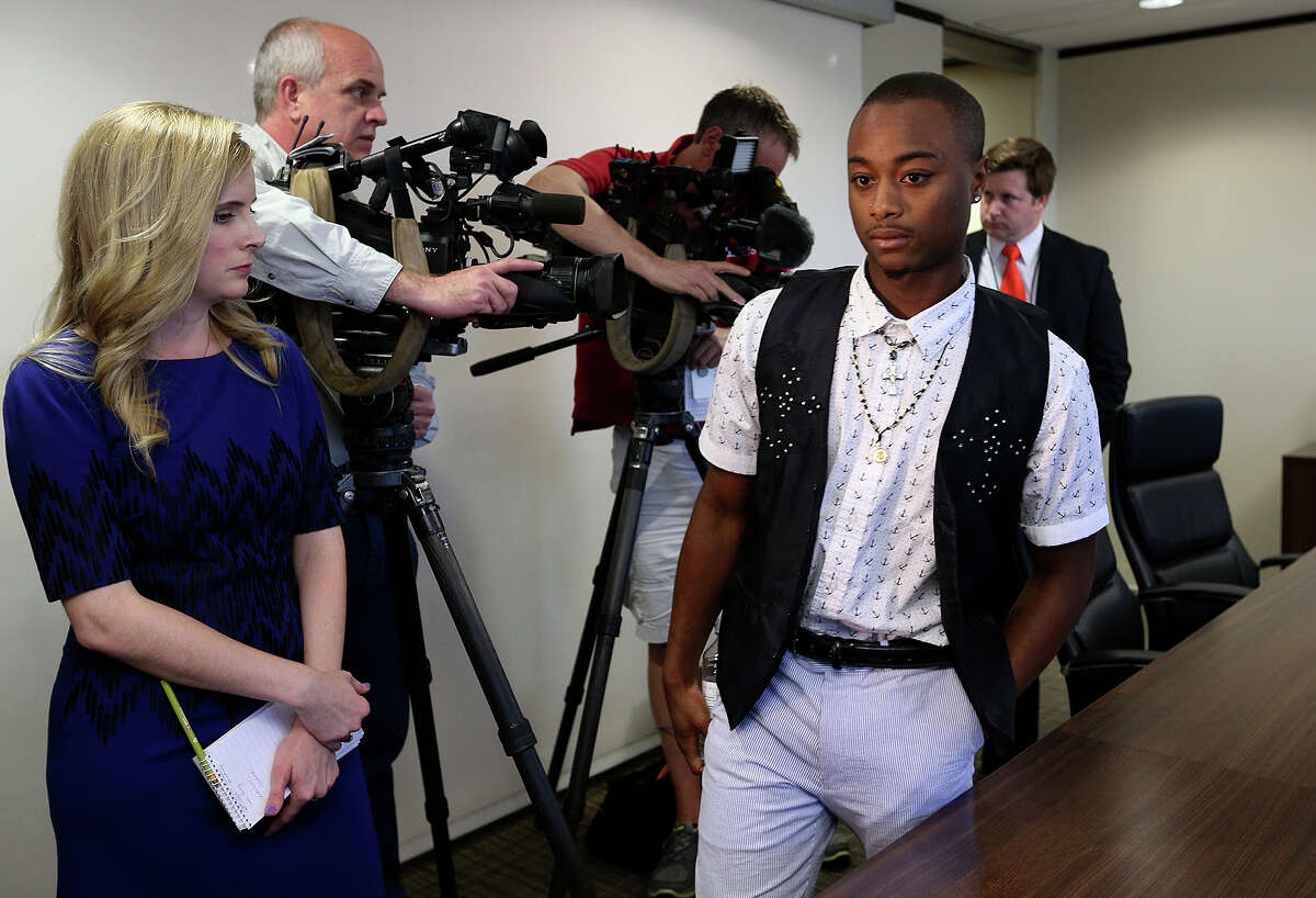 Jahson Arneaud, 20, arrived at news conference at the law office of Thomas J. Henry on Thursday. Arneaud was the driver of the vehicle in a crash with an SUV driven by a San Antonio police officer that was transporting Mayor Ivy Taylor on April 18. In the car with Arneaud were sisters Ajuana Baldwin and Tomekia Baldwin, who is in serious condition at San Antonio Military Medical Center. The sisters, together with their mother, Sharlene Lewis, and Tomekio Baldwin's son, Noah Baldwin, have filed a lawsuit, saying that the city officer was at fault. On Wednesday, the police department released its investigation concluding the opposite, that the vehicle with the mayor had the right of way.