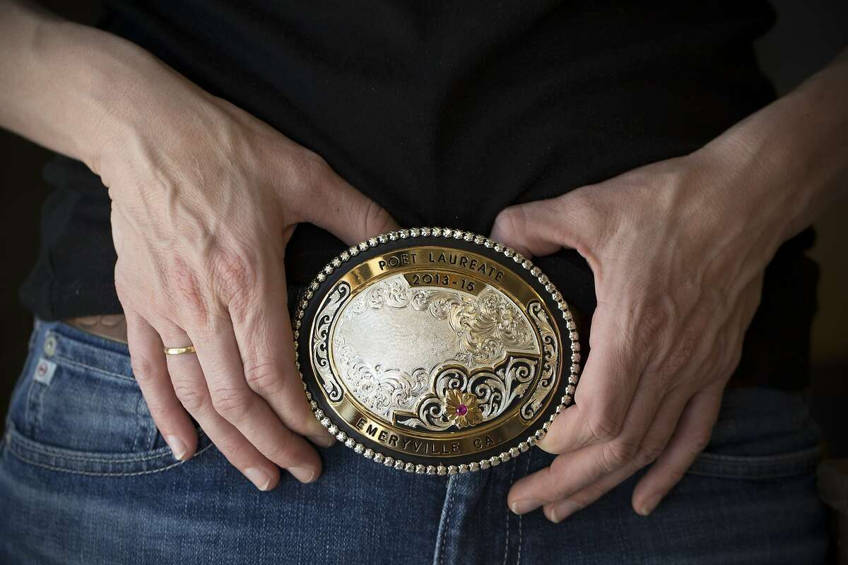Sarah Kobrinsky wears a belt buckle with her accolade as the Poet Laureate of Emeryville. She was pushed out of Emeryville after the landlord raised her rent. She is photographed at store run by her and her husband, Jered's Pottery, in Berkeley, Calif. on Thursday, April 30, 2015.