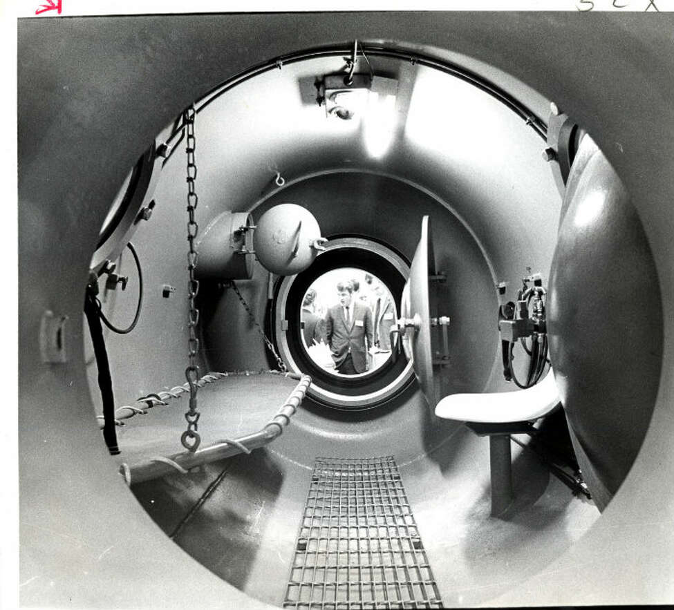 1969 - Looking through a decompression chamber by Wilson Industries.