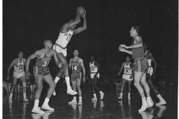 Wilt Chamberlain battles for a rebound with Zelmo Beatty