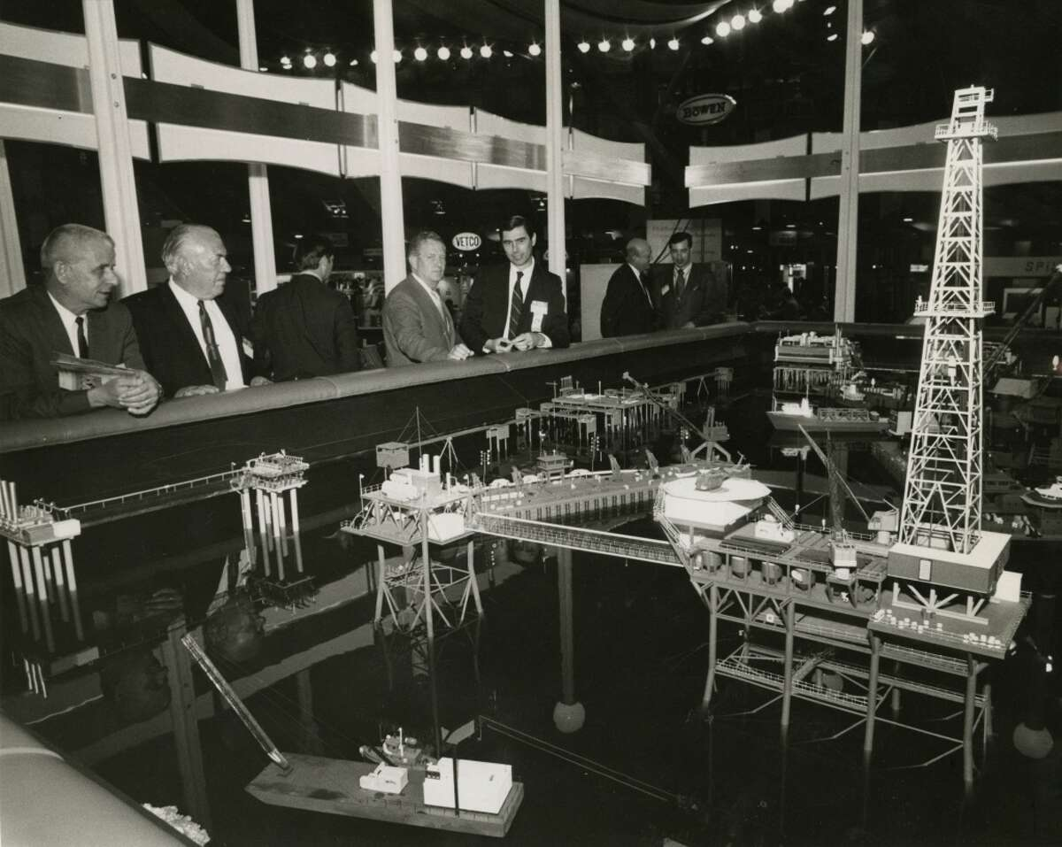 1971 - Attendees at the third annual Offshore Technology Conference gathered around an elaborate display of miniature marine drilling platforms, process facilities and derrick barges in the Halliburton exhibit. The three-day conference, was held in the Astrohall, attracting about 5,000 registrants on opening day.