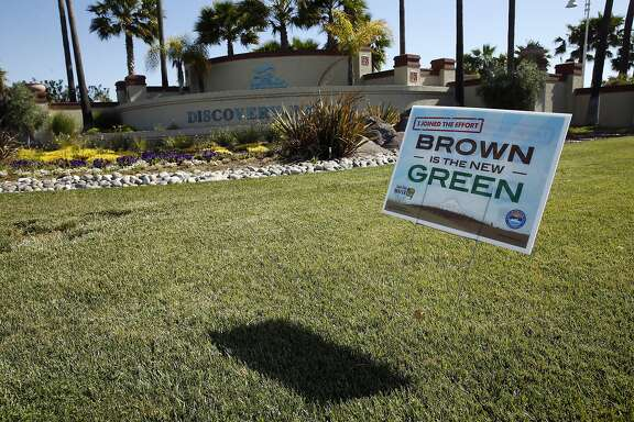 """Brown is the New Green"" sign at Discovery Bay Boulevard entrance in Discovery Bay, Calif., on Thursday, April 30, 2015."