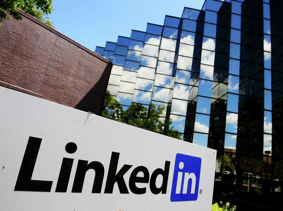In business, it's vital to focus on developing a quality LinkedIn profile and avoid making a poor first impression. Photo: Paul Sakuma, STF / AP