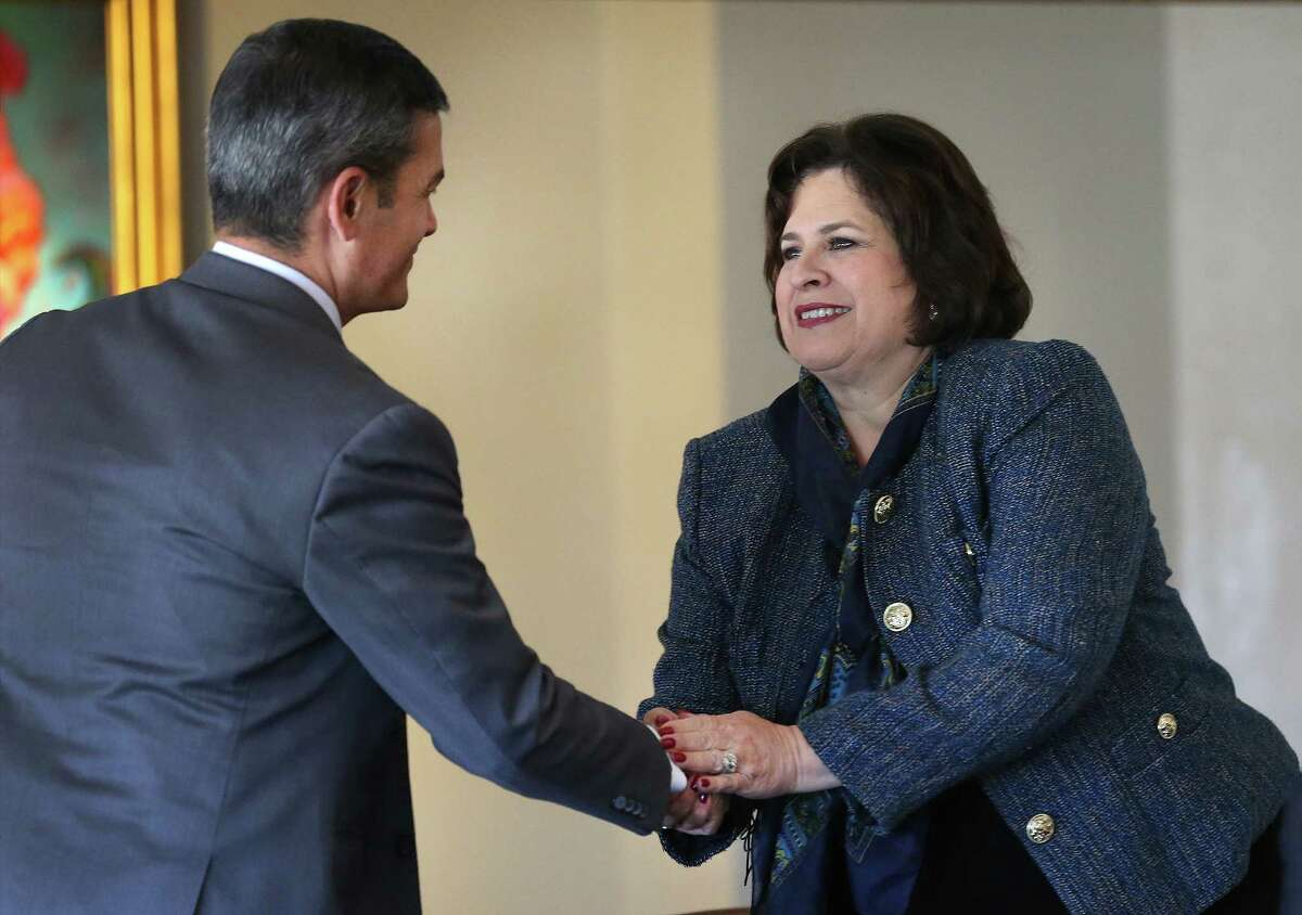 """Mayoral candidates Leticia Van de Putte, right, and Mike Villarreal greet each other before they speak at the 2015 San Antonio Mayoral Forum titled """"The Future of Transportation in the Alamo City"""", held at The Plaza Club. Wednesday, Feb. 25, 2015."""