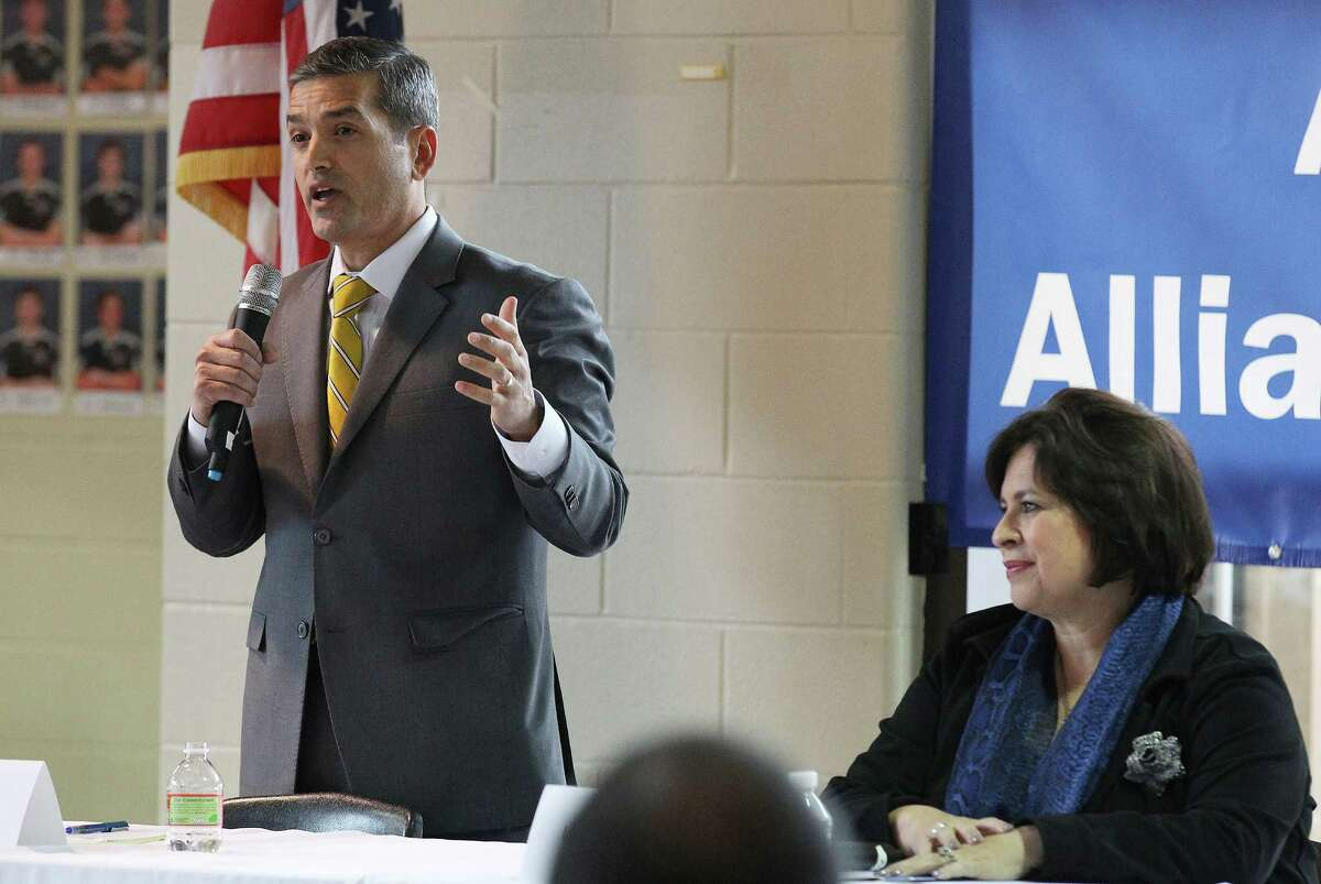 Mayoral candidates Mike Villarreal (left) and Leticia Van de Putte take part in a mayoral forum hosted by the Asian American Alliance of San Antonio held at Churchill High School on Saturday, Feb. 7, 2015. Villarreal and Van de Putte, including Tommy Adkisson, fielded questions for nearly an hour and a half to a packed room of Asian American constituents. Topics included their visions of San Antonio, potential inclusion of Asian Americans in local government and future economic goals focused on local private business. (Kin Man Hui/San Antonio Express-News)