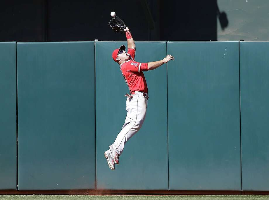 Los Angeles Angels center fielder Mike Trout makes a leaping catch for last out of the game on a fly ball from Oakland Athletics' Ike Davis during the ninth inning of a baseball game Thursday, April 30, 2015, in Oakland, Calif. Los Angeles won 6-5.  (AP Photo/Marcio Jose Sanchez) Photo: Marcio Jose Sanchez, Associated Press
