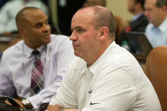 """Houston Texans head coach Bill O'Brien sits next to general manager Rick Smith in the """"war room"""" waiting for the start of the NFL Draft at NRG Stadium on Thursday, April 30, 2015, in Houston."""