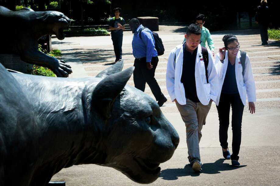 Tommy Jiang, left, and Megha Makanji, right, walk the University of Houston, Thursday, April 30, 2015, in Houston. The University of Houston has gained ground in its quest to become a first-class research university. On Wednesday, Chancellor Renu Khator offered the first public glimpse of her next aspiration for UH - admission into an elite group of North America's best universities. ( Marie D. De Jesus / Houston Chronicle ) Photo: Marie D. De Jesus, Staff / © 2015 Houston Chronicle