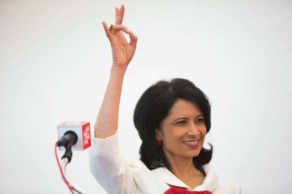 University of Houston Renu Khator thanks the university band for welcoming her to the podium to announce Hunter Yurachek as the new Vice President of Intercollegiate Athletics at the University of Houston, Thursday, April 30, 2015, in Houston. ( Marie D. De Jesus / Houston Chronicle )